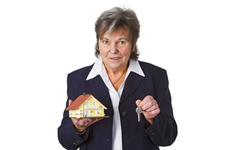 Female senior with toy house isolated on white background photo