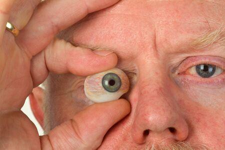 Glass eye in detal. Closeup shot in studio. Stock Photo - 14341743