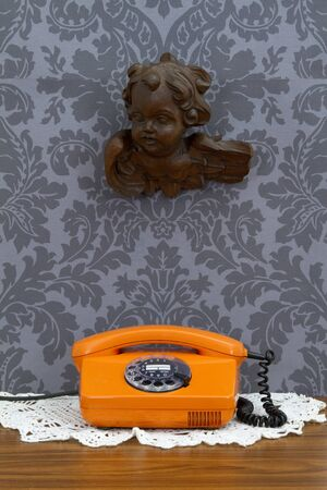 Concept - retro communication on floral wallpaper photo