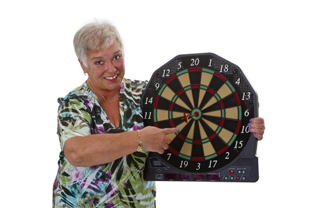 exempted female: Female senior with darts - isolated on white background Stock Photo
