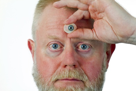 Man hold glasseye on his forehead Stock Photo - 15784383
