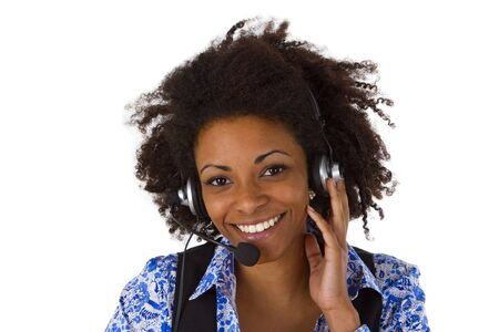 Female customer support operator with headset and smiling - isolated on white background photo