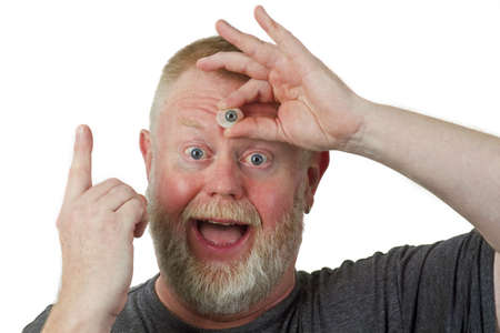 Man hold glasseye on his forehead photo