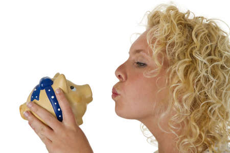 Young woman kissing big piggy bank isolated on white background Stock Photo - 16828106