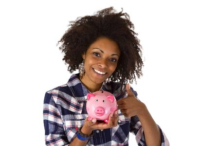 Female afro american with piggy bank isolated on white background photo