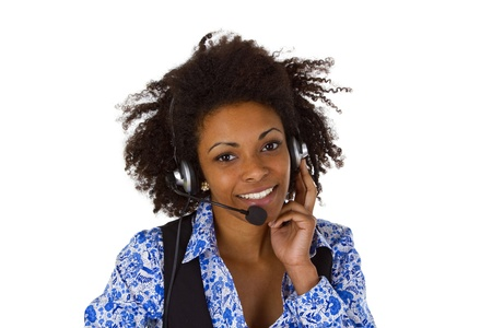 Female customer support operator with headset and smiling - isolated on white background Stock Photo - 17539405