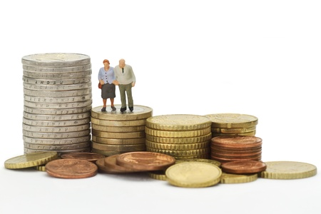household money: Seniors figurines with euro coins isolated on white background Stock Photo