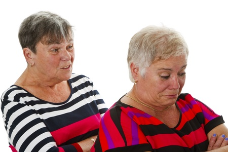 enmity: Two female seniors in dispute - isolated on white background Stock Photo