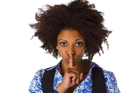 アフロアメリカン: 若いアフロ アメリカンと言ってシッ - 静かに - 白い背景に分離 写真素材