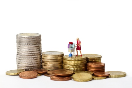 Concept shopping - figurine with euro coins isolated on white background photo