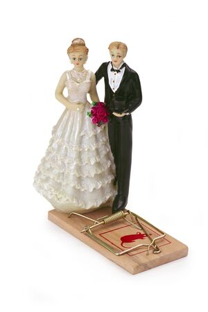 mouse trap: Wedding couple with mousetrap isolated on white background