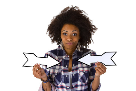 undetermined: Young african american holding blank arrows - isolated on white background Stock Photo