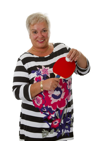 ping pong: Sporty female senior with ping pong paddle - isolated on white backgorund Stock Photo