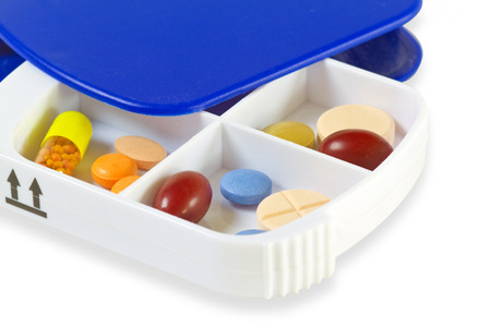 pillbox: Pill Box with pills on bright background Stock Photo