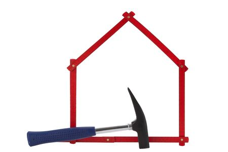 homeownership: Folding Rule with hammer on white background
