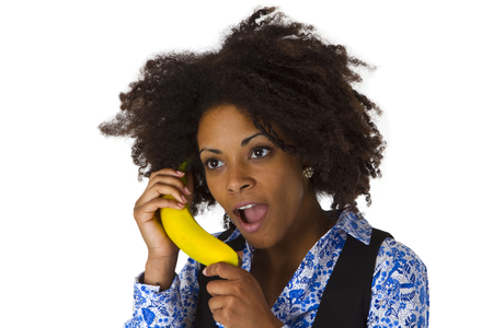 Female afro american with banana - isolated on white background photo