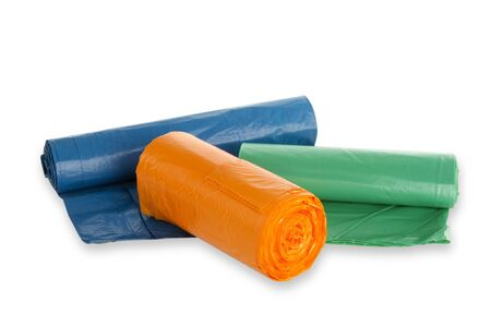 degradable: Rolls of trash bags on white background