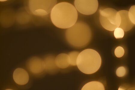 Beautiful Bokeh in golden colors Imagens - 56598525