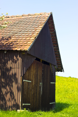 Picture of a idyllic Woodshed in Springtime Stock Photo
