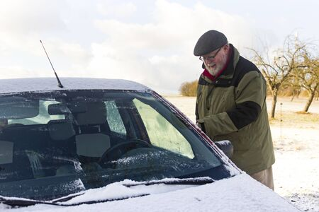 Senior remove car from hoarfrost - Outdoor Shot photo