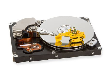 hard disk: HDD with toy crawler mounted - data security concept.