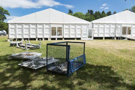 white wood floor: Large Exhibition Tent with glass door in Summer - Outdoor shot.