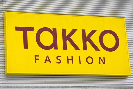 LINDEN, GERMANY JULY, 2017: TAKKO textile fashion boutique chain sign. TAKKO is a GERMAN textile fashion boutique, based in Telgte, Nordrhein Westfalen, Germany.