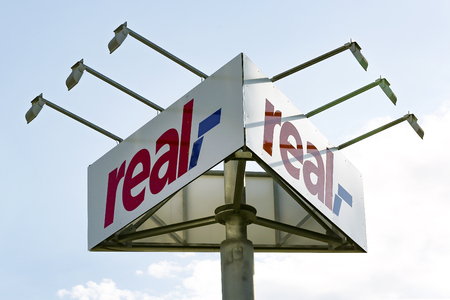 WETZLAR, GERMANY JULY, 2017: Real Logo from Real supermarket. Real is a retail chain of the Metro Group, which operates several hundred supermarkets through the Real Group Holding GmbH in Germany