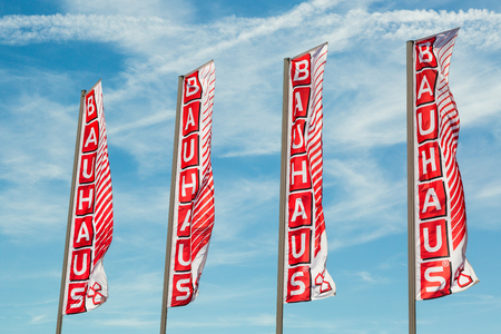 WETZLAR, HESSEN, GERMANY - June 2017 : Big BAUHAUS Flags agains blue Sky. Headquartered in Switzerland, Bauhaus is famous and one of the biggest chains of do it yourself stores all over Europe. Editorial