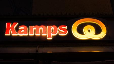 GIESSEN  GERMANY DECEMBER 2017: Illuminated Red Logotype of KAMPS.  KAMPS is a german bakery chain based in Schwalmtal Nordrhein Westfalen. Publikacyjne