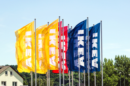 WETZLAR, HESSEN, GERMANY - June 2017 : IKEA Flags against blue Sky. IKEA is a large furniture retailer and sells furniture ready to assemble. Founded in Sweden in 1943.