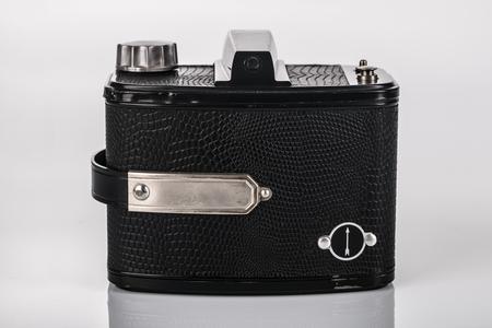 Backside of analog retro Camera 6x9 on bright background Stock Photo