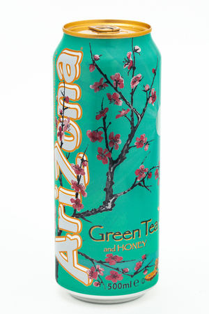 HUETTENBERG, GERMANY- JULY 6, 2018: Aluminium can of Arizona Green Tea with Honey flavor soft drink on white background Editorial