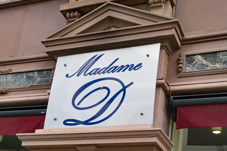 Wiesbaden, Germany - June 03 2018: MADAME D logo on a facade.  MADAME D fashion outlet store.