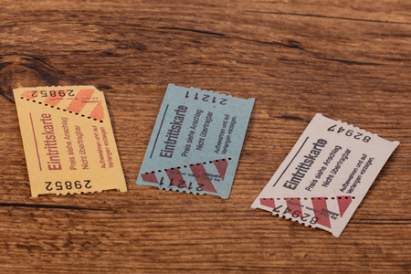 Three Paper Tickets on a wooden Table Banque d'images