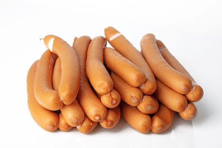 Fresh Frankfurter Sausages on white background Banque d'images