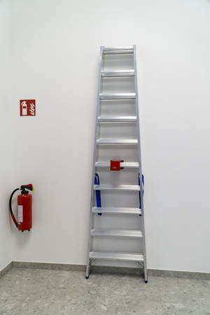 Fire extinguisher and ladder fixed in a modern building