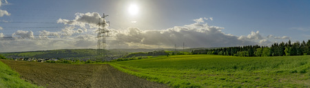 Panorama from summer landscape with electricity pylon in germany Фото со стока