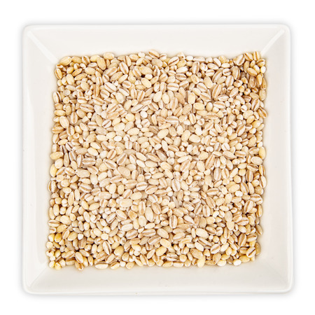 Pearl Barley in a bowl isolated on white background