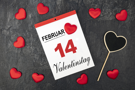 Little velvet hearts with a calendar. Valentinstag in german language means Valentines Day.