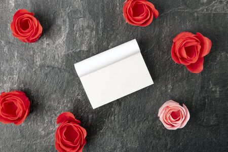 Wax Rose blossoms with a blank calendar. Concept romantic.