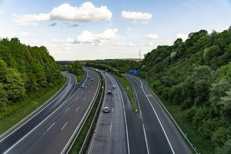 Highway in Germany with cars and sky with big clouds