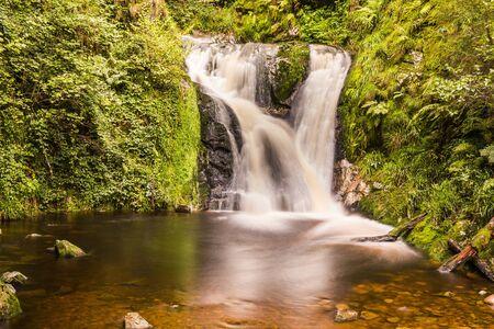 Idyllic forest waterfall in Arheiligen Schwarzwald Germany