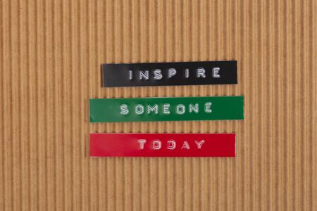 Concept Inspire someone today - Label Print with the words - Inspire someone today - on yellow Background