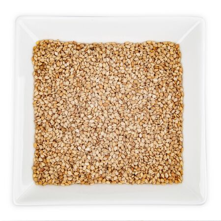 Sesame Seeds in Bowl isolated on white background