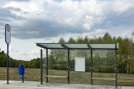 Modern Bus Stop with trash can with cloudy Sky Reklamní fotografie