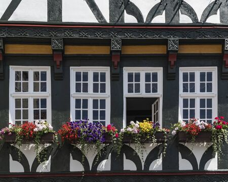 Flowers on Balcony on traditional half timbered houses in a old town Fritzlar in Germany