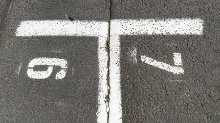Parking Zone marked with six and seven on asphalt  Stock fotó