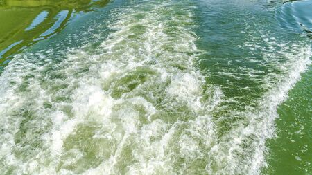 Waves in motion from a ship on river Mosel