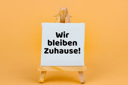 Concept: Corona Crisis - German Language - Wir bleiben Zuhause - We stay at Home and stay Safe Zdjęcie Seryjne